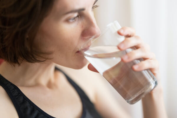 Coughing or choking while drinking water